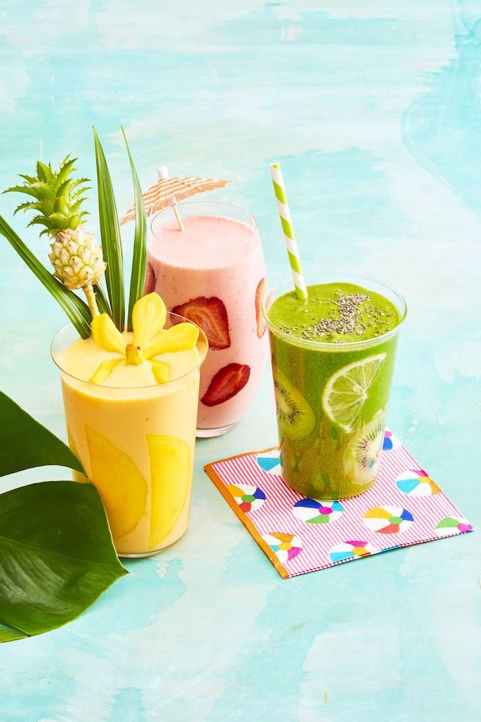 yellow smoothie with mango, green smoothie with kiwi, pink smoothie with strawberries, smoothie recipes
