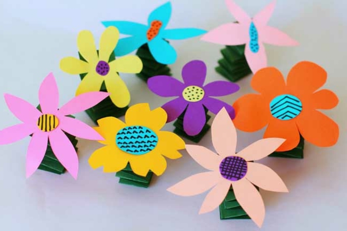 colourful flowers, made of paper, literacy activities for preschoolers, orange and yellow, purple and blue