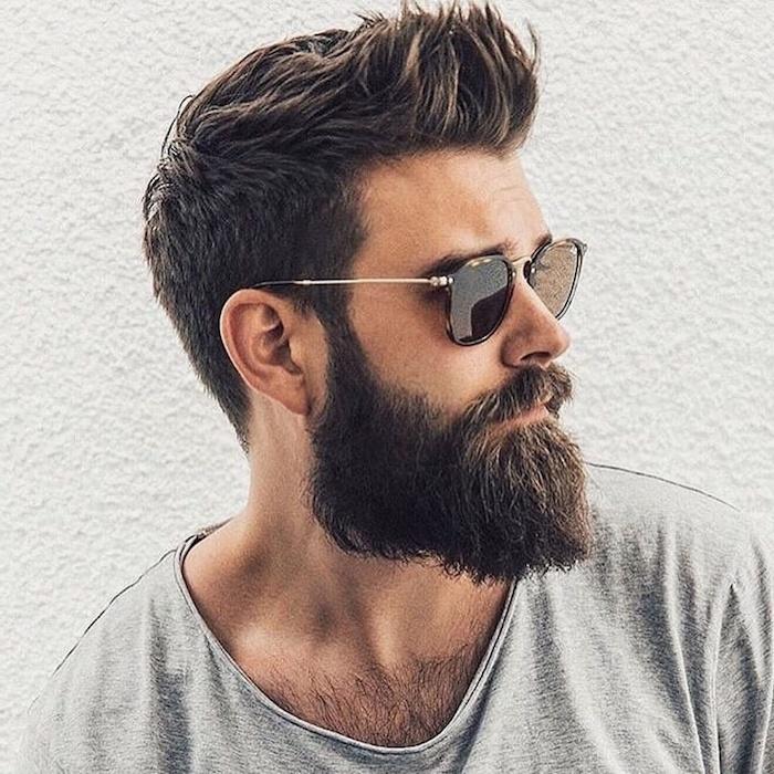 short guy haircuts, man wearing sunglasses, grey shirt, brown hair and beard