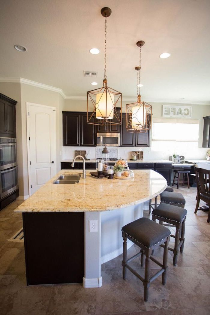 curved kitchen island, black wooden bar stools, island countertop, tiled floor, wooden cabinets