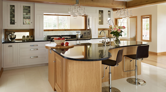 kitchen island breakfast bar, wooden kitchen island, black countertops, white cabinets, black leather bar stools