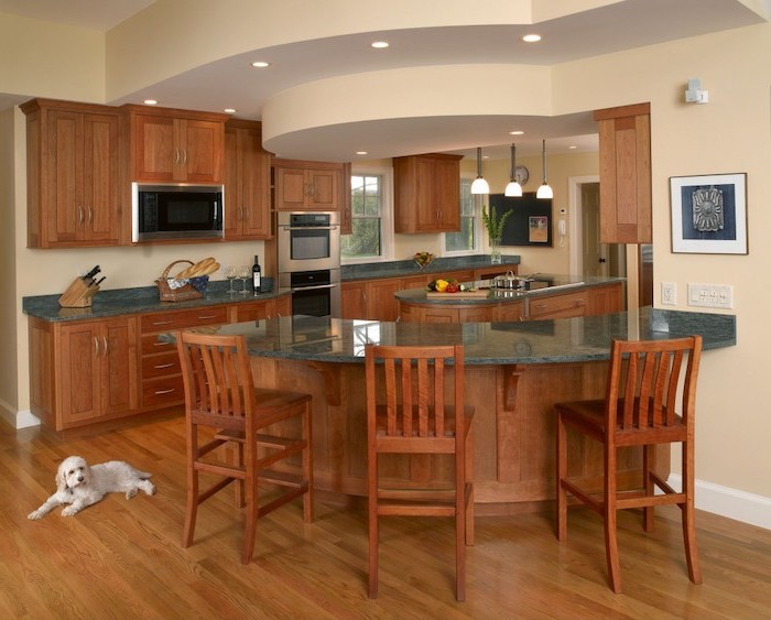wooden curved, kitchen island breakfast bar, granite countertops, wooden bar stools, wooden floor