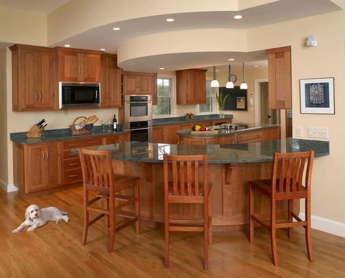 wooden curved, kitchen island breakfast bar, granite countertops, wooden bar stools, wooden floor