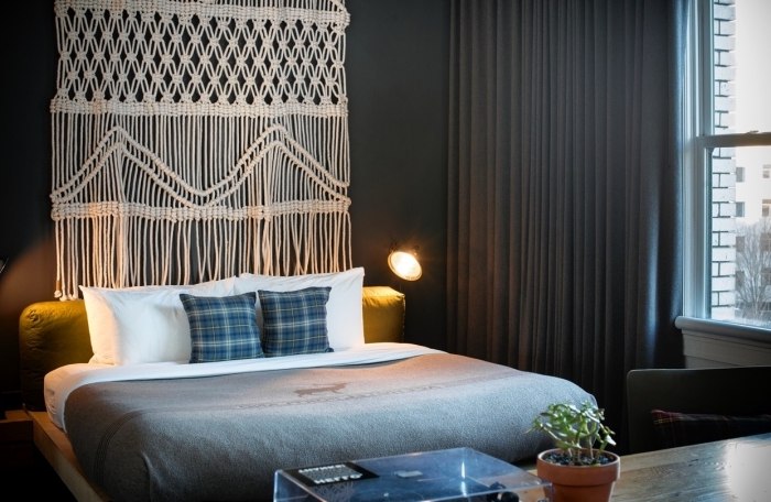 black wall, grey curtains, macrame tutorial, potted plant, white and grey bed linen
