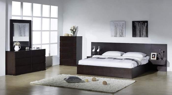 dark wooden bed frame, drawers and shelves, wooden floor, white carpet, master bedroom decorating ideas