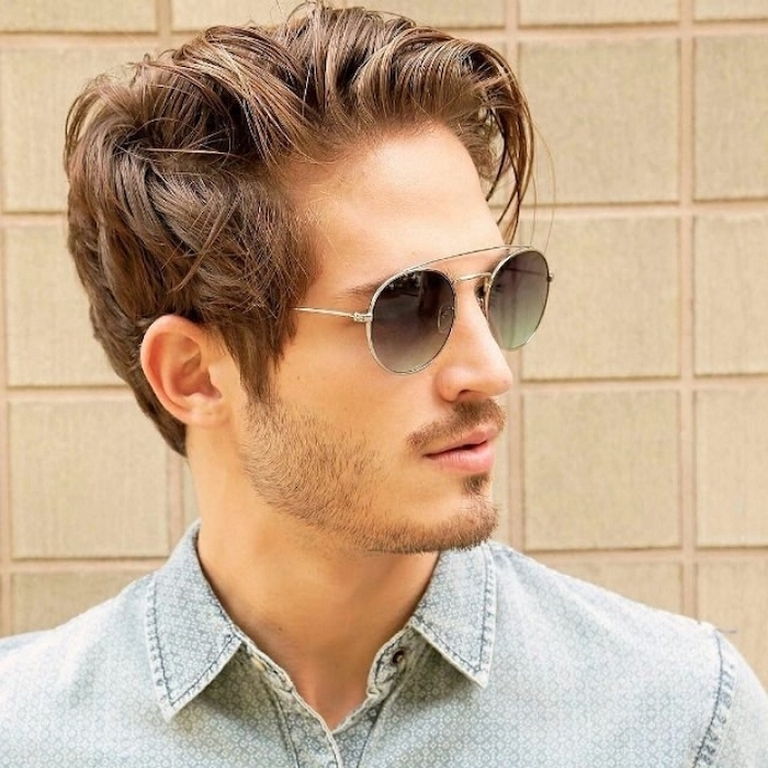 medium hairstyles for men, denim shirt, brown messy hair, man wearing sunglasses