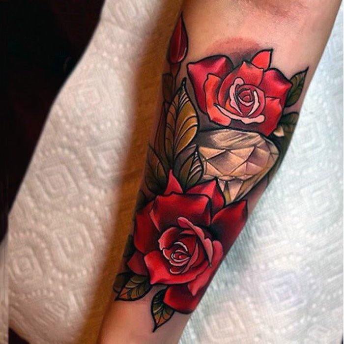 white paper, large diamond, surrounded by red roses, chest tattoos for women, forearm tattoo