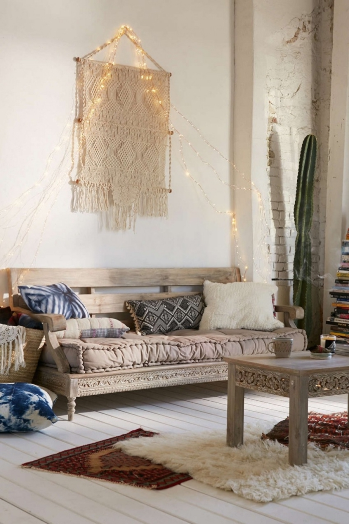 fairy lights, macrame tutorial, wooden sofa, wooden table, colourful throw pillows, white brick wall