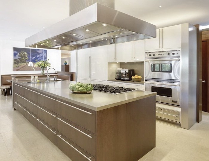 wooden drawers, white cabinets, kitchen island breakfast bar, white tiled floor