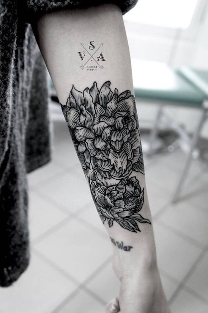 large flower, forearm tattoo, side tattoos for girls, black and white photo, tiled floor