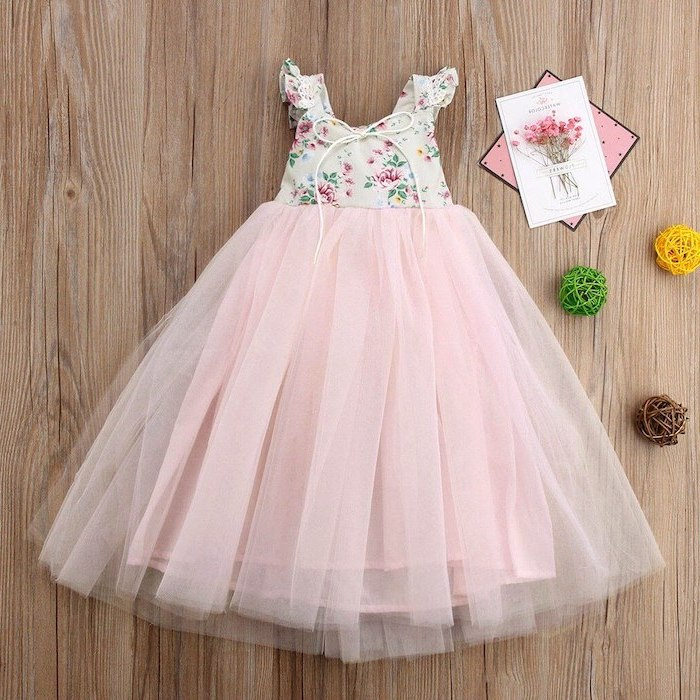 floral top, pink tulle bottom, on a wooden background, girls formal dresses