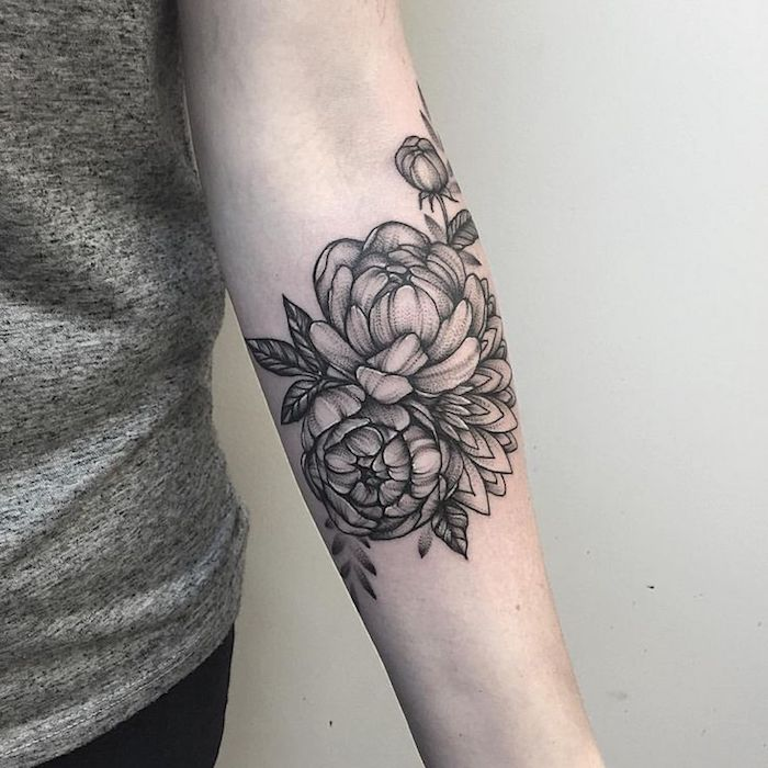 white background, small meaningful tattoos, flower forearm tattoo, grey top