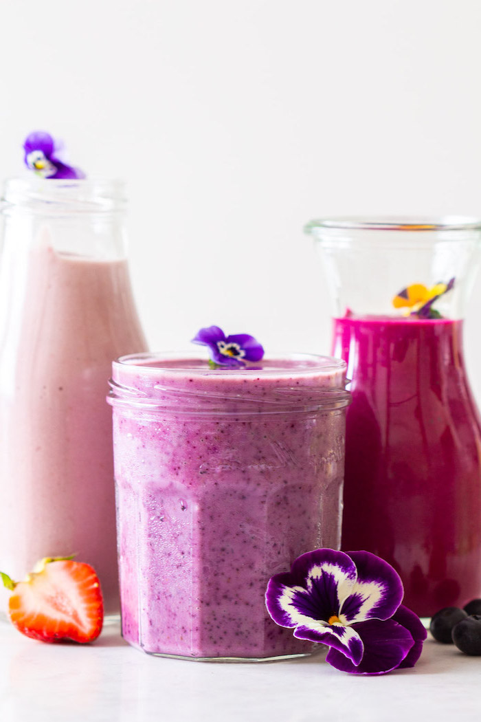 tall bottles and jars, purple flowers, how to make a strawberry smoothie