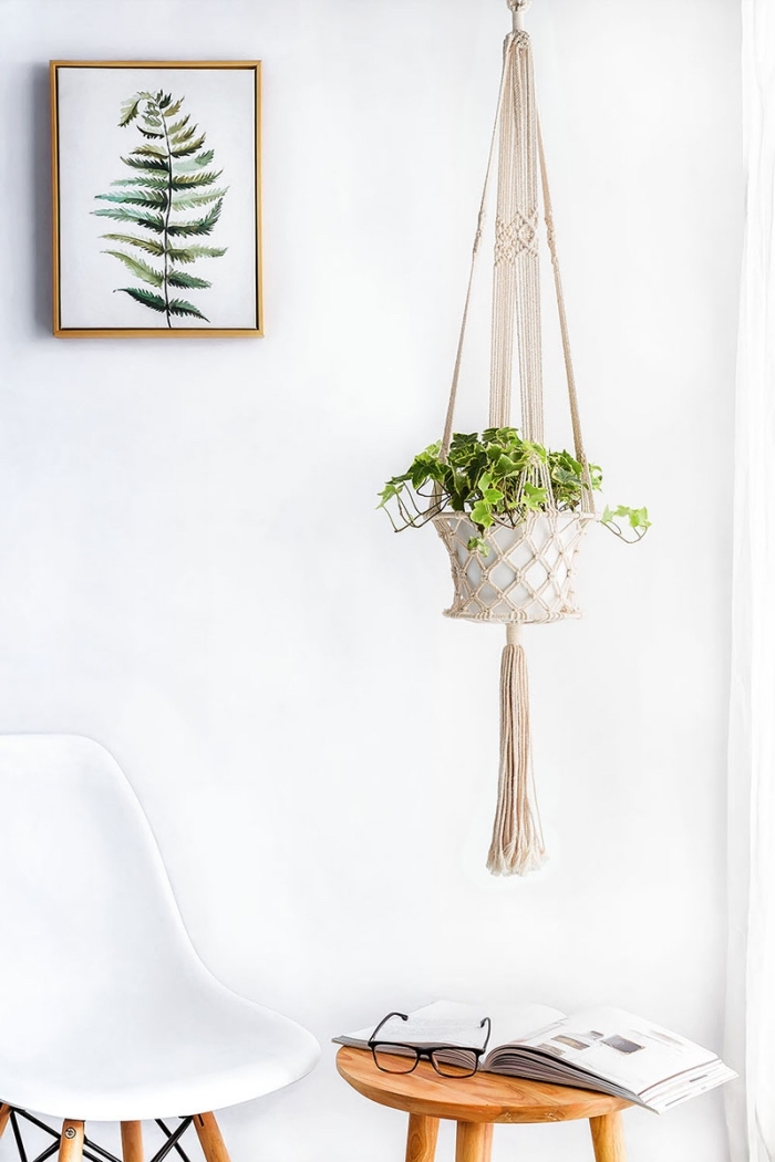 free macrame patterns and instructions, white wall, plant hanger, potted plant, white chair, open book