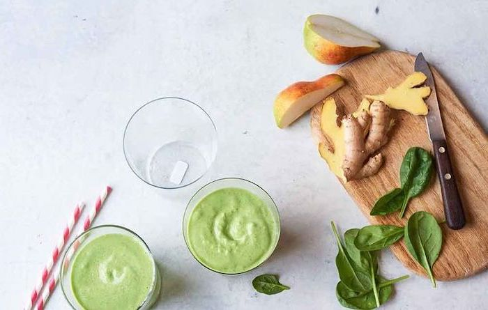 wooden cutting board, easy smoothie recipes, ginger and pear slices, three glasses