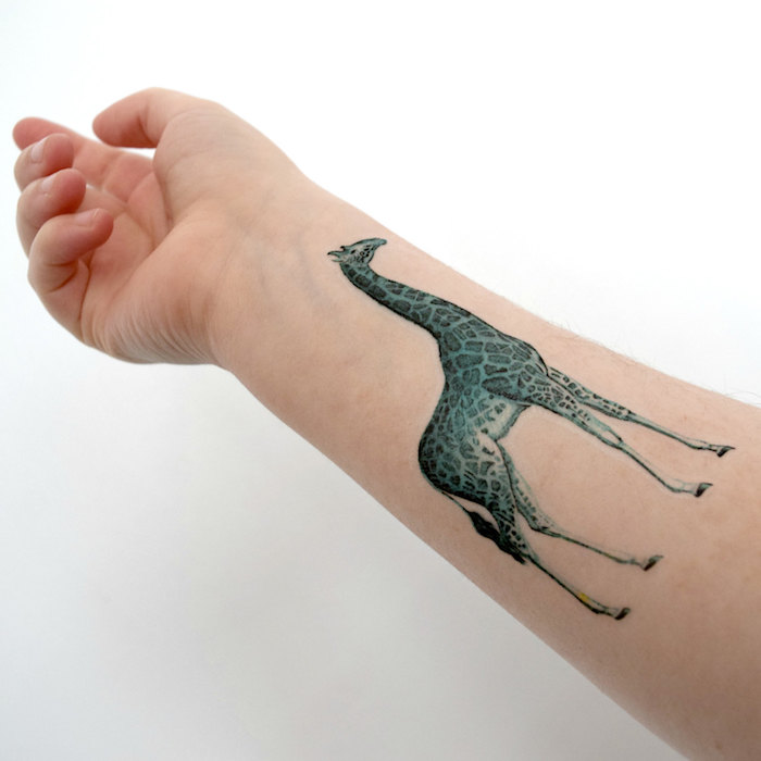 blue giraffe, forearm tattoo, tattoos for moms, white background