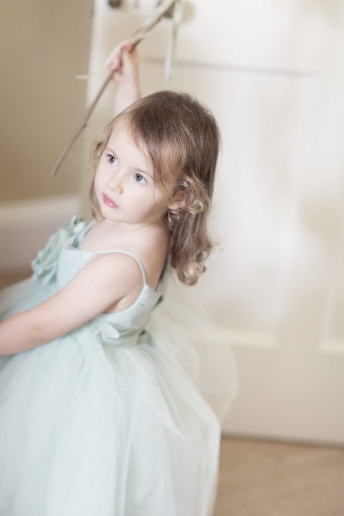 mint green dress, blonde curly hair, toddler girl dresses, wooden floor, white door