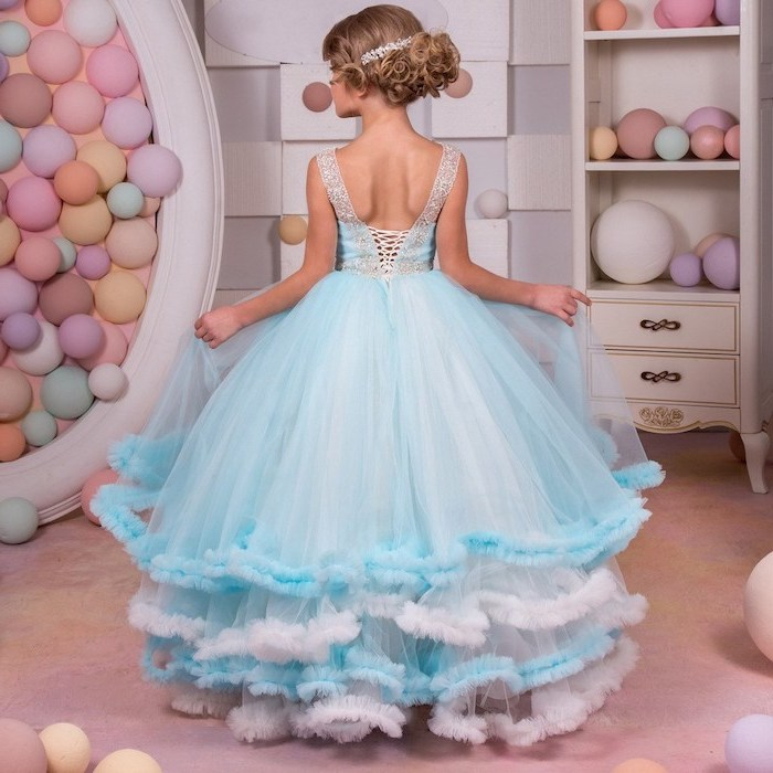 blue and white tulle dress, toddler girl dresses, blonde hair, in a low updo, colourful background