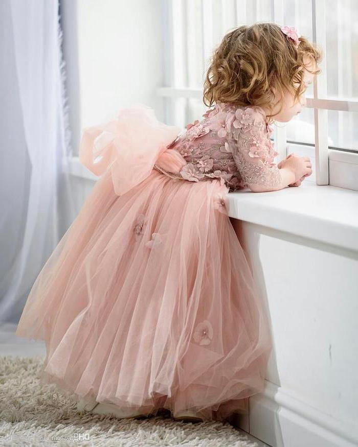 pink lace and tulle dress, little girl, looking out the window, flower girl dress, short blonde wavy hair