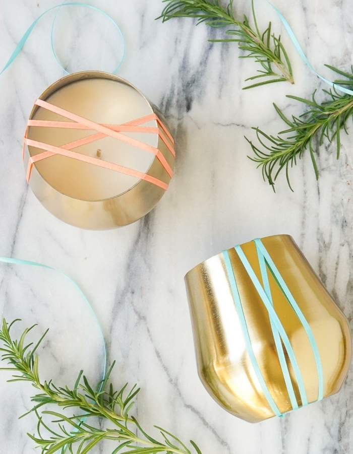marble countertop, golden vases, filled with candle wax, candle wedding favors, rosemary branches