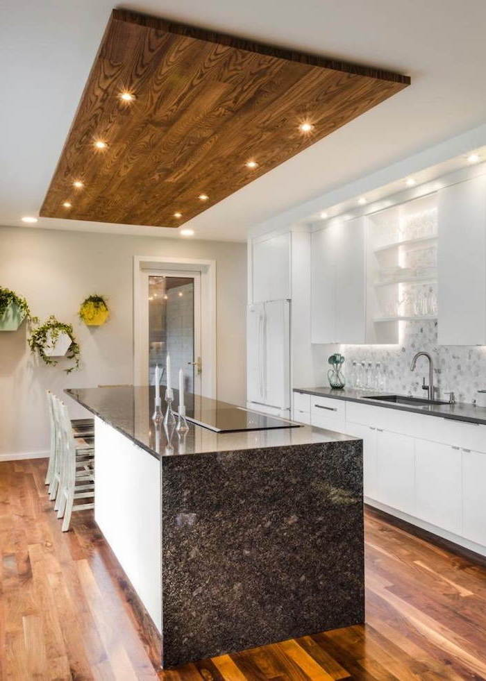 wooden floor, granite countertops, tiled backsplash, large kitchen island with seating, wooden block on the ceiling