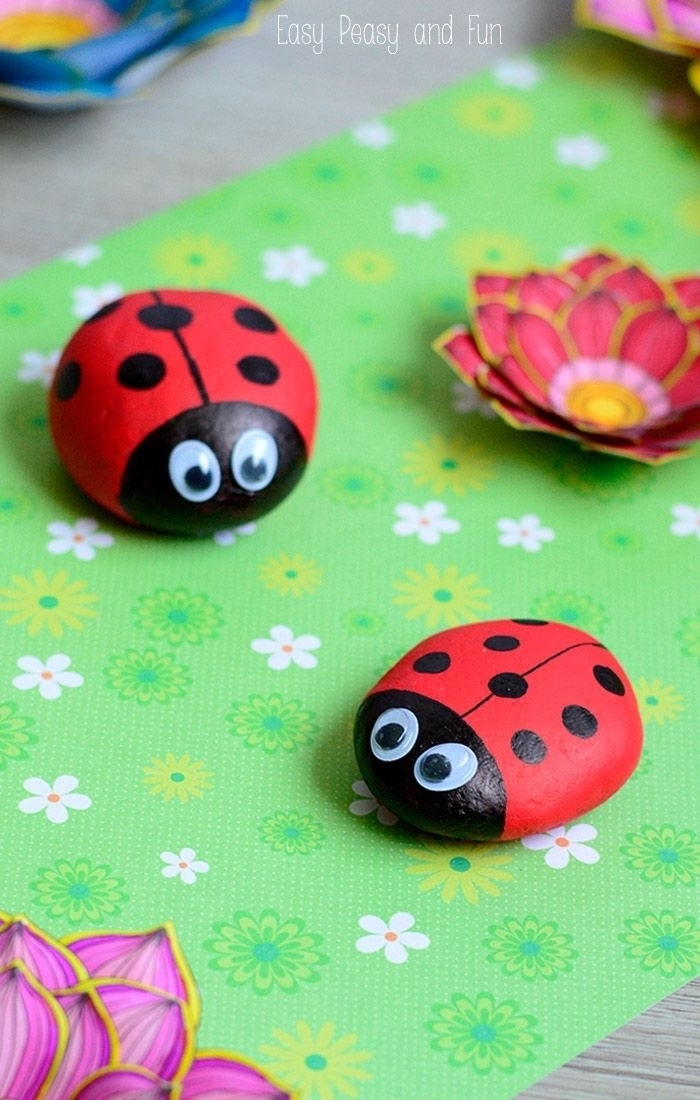 preschool games for kids, green paper, ladybugs made of rocks, with googly eyes