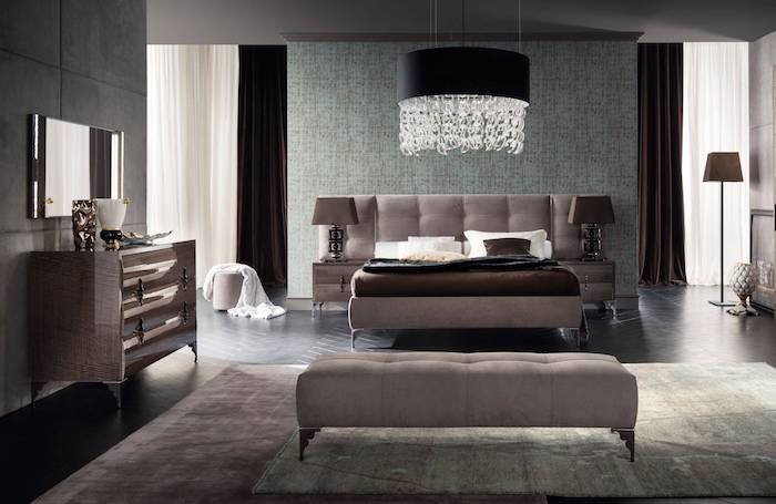 how to decorate a small bedroom, grey bed frame and ottoman, wooden floor, printed carpet