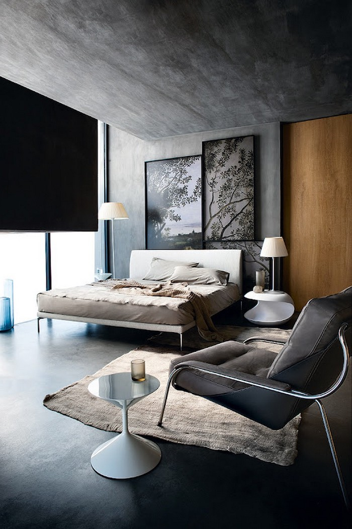 grey granite walls and ceiling, white bed frame, hanging art, how to decorate a small bedroom