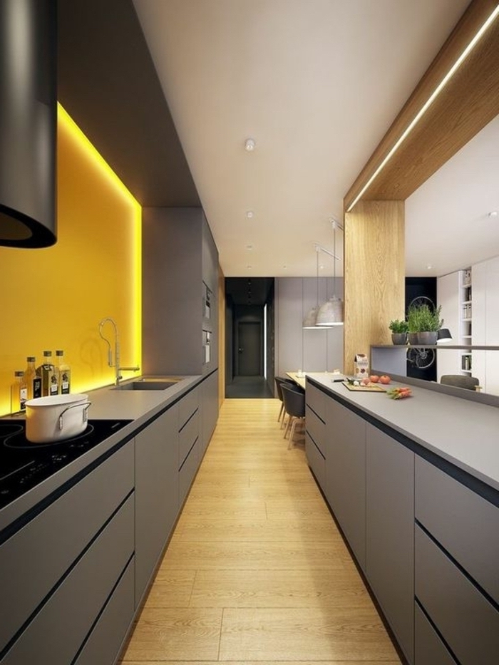 narrow kitchen island, grey cabinets and drawers, yellow backsplash, led lights, wooden floor