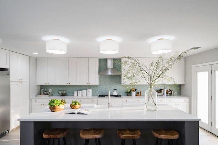 wooden bar stools, white countertops, white cabinets, blue backsplash, narrow kitchen island