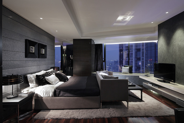 grey walls, wooden floor, grey bed frame and sofa, how to decorate a small bedroom, large windows