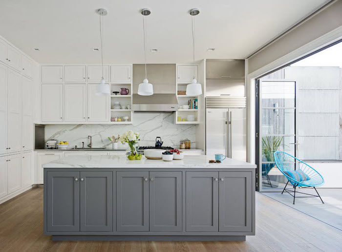 grey cabinets, wooden floor, island cabinets, white cabinets, marble backsplash, open shelving