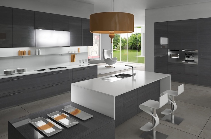 kitchen island cabinets, grey cabinets and drawers, white bar stools, tiled floor, hanging orange lamp