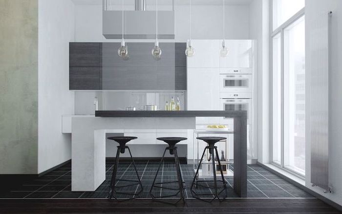 black tiled floor, grey cabinets, black metal bar stools, island cabinets, hanging lamps