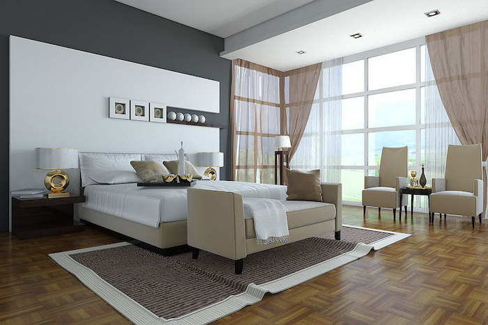grey and white wall, white leather bed frame, armchairs and sofa, modern bedroom ideas, wooden floor