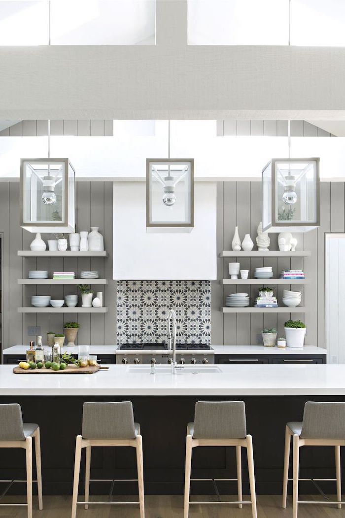 grey bar stools, grey backsplash, hanging lanterns, black kitchen island, island cabinets, open shelving