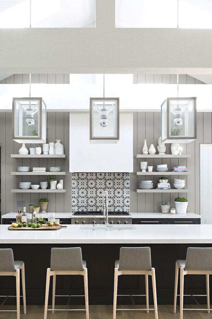 grey bar stools, grey backsplash, hanging lanterns, black kitchen island, island cabinets, open shelving