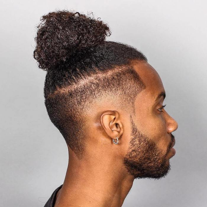 black curly hair, in a bun, medium hairstyles for men, white background