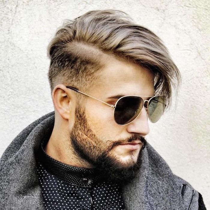 man wearing sunglasses, grey jacket, hair styles for men, blonde hair, white background