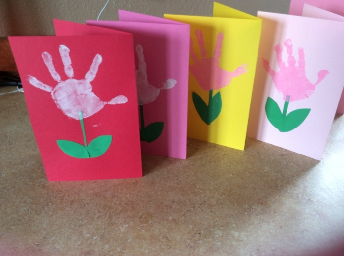 greeting cards, preschool learning activities, handprints on the front, pink and yellow paper
