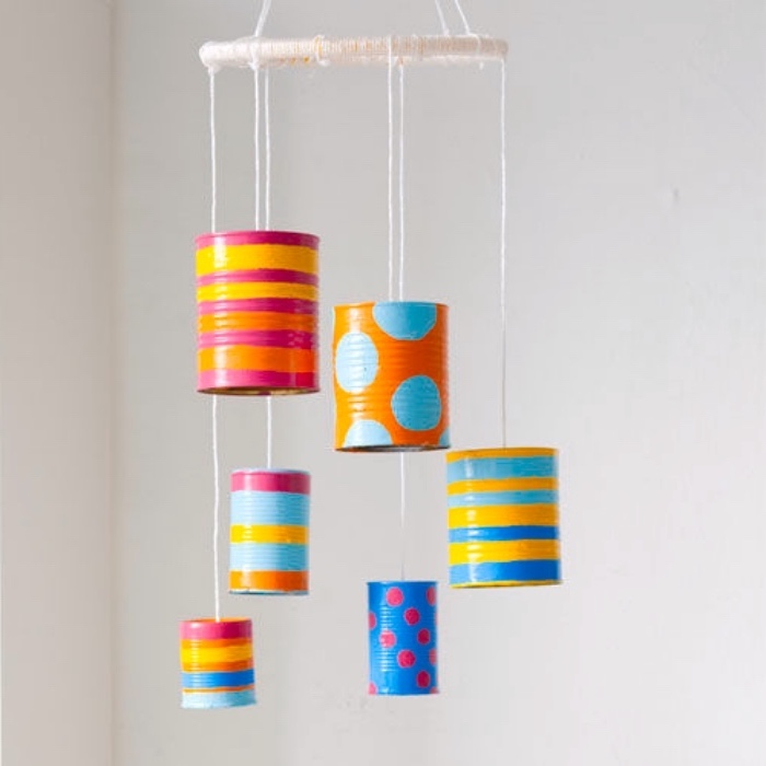 preschool learning, tin cans, painted in different patterns, hanging on macrame