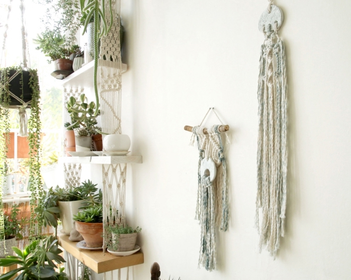 how to make macrame wall hanging, white hanging wooden shelves, white wall, potted plants