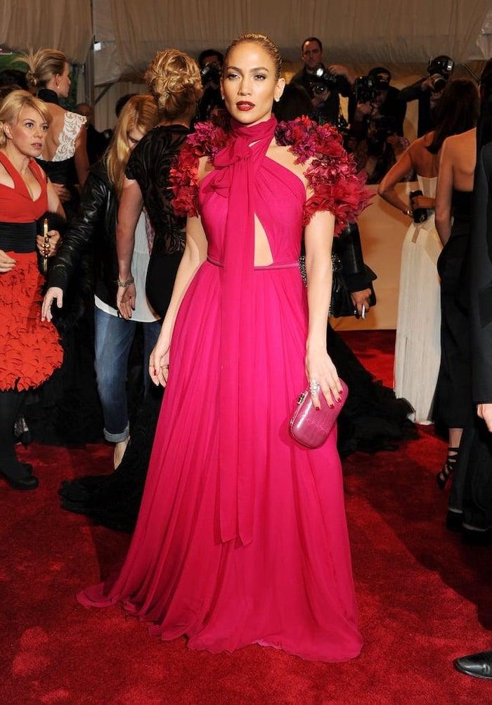 hot pink dress, jennifer lopez, met gala dresses, pink clutch bag, photographers in the background