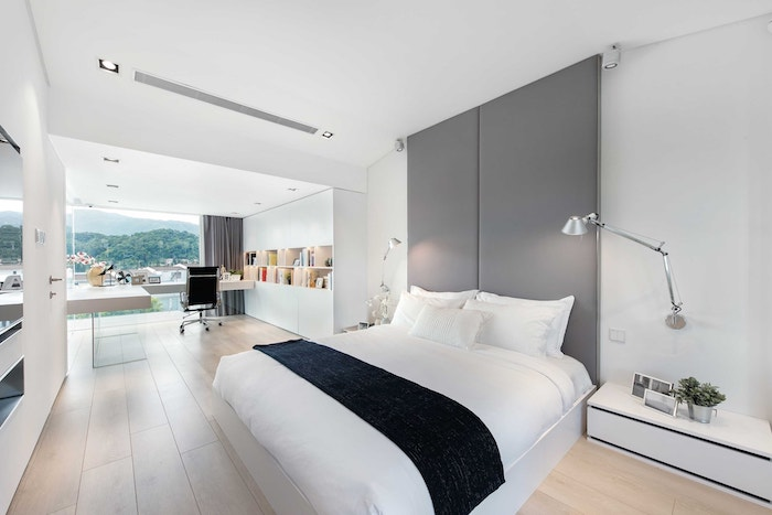 grey leather accent wall, wooden floor, office space, modern bedroom ideas, white night stand