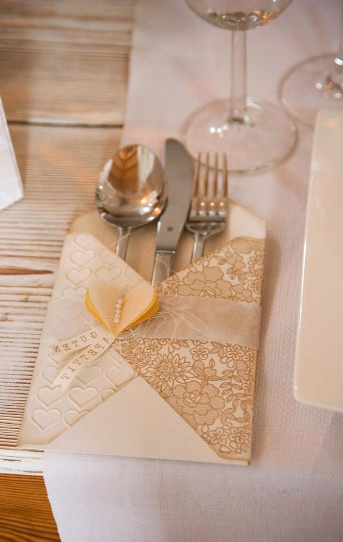 luxury wedding napkins, silverware inside, fancy napkin folding, white table runner, wooden background