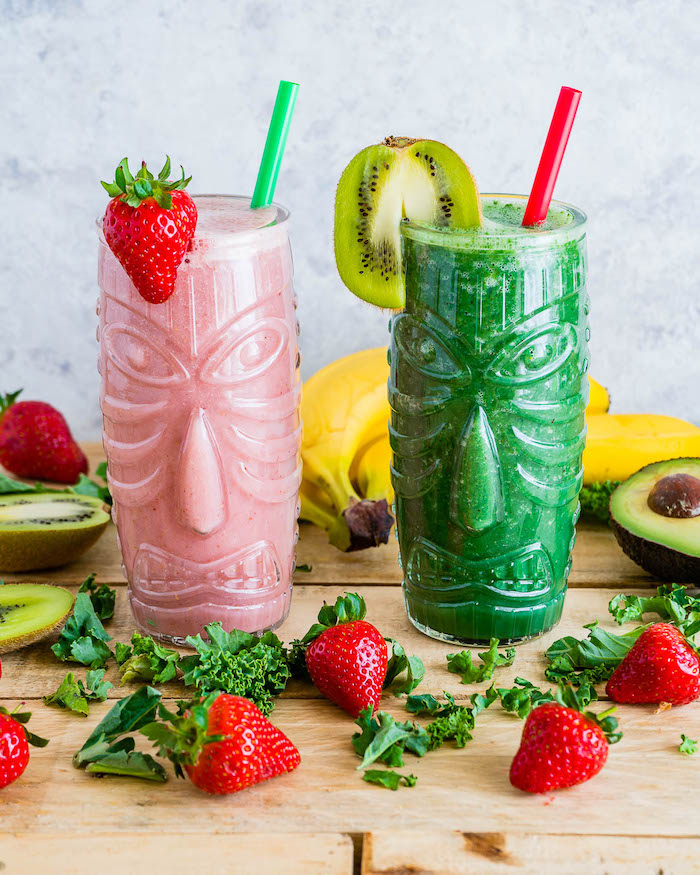 tall glasses, full of pink and green smoothies, different fruits, scattered around, smoothie recipes