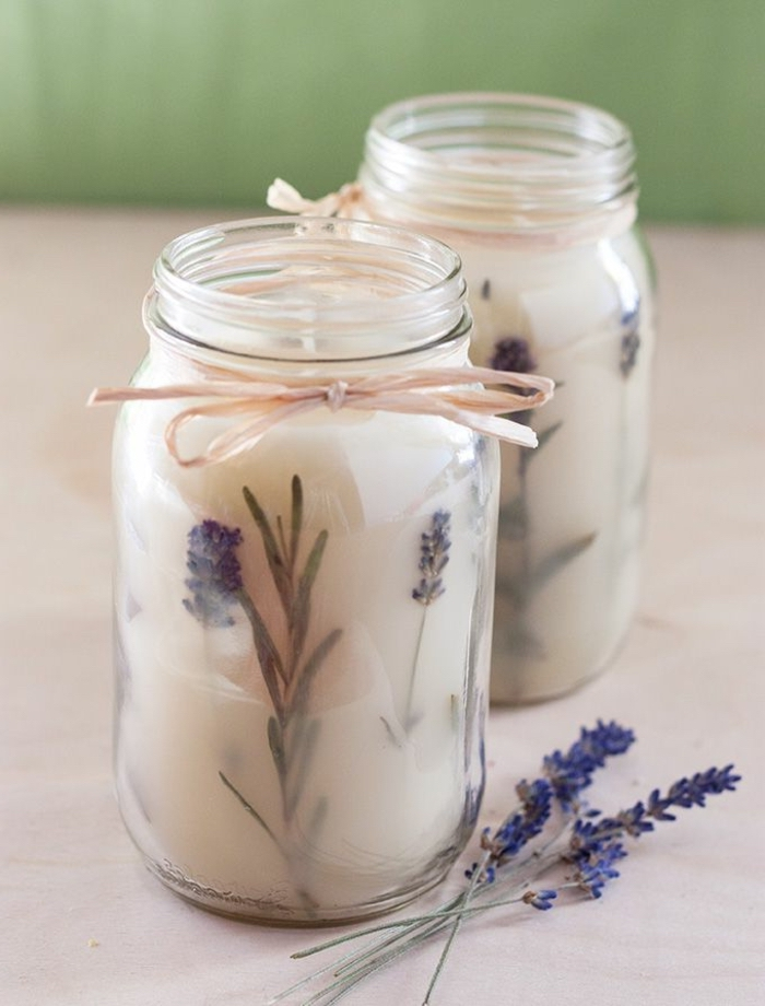 two large jars, filled with candle wax, mixed with lavender, diy candles