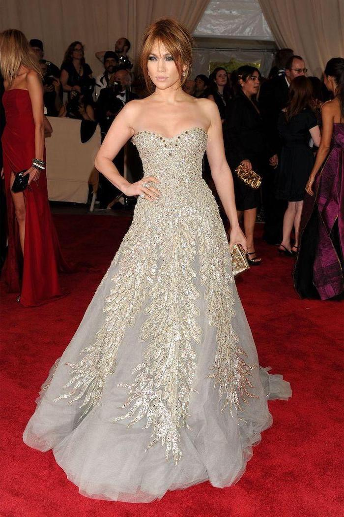 met gala 2017, jennifer lopez, wearing a grey strapless dress, with sequins, brown hair, in a low updo