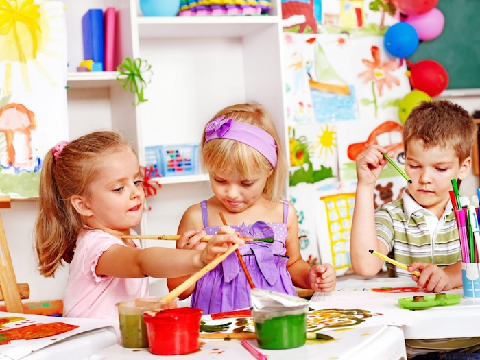 little kids, painting with paintbrushes, red and green paint, preschool activities, boy holding pencils