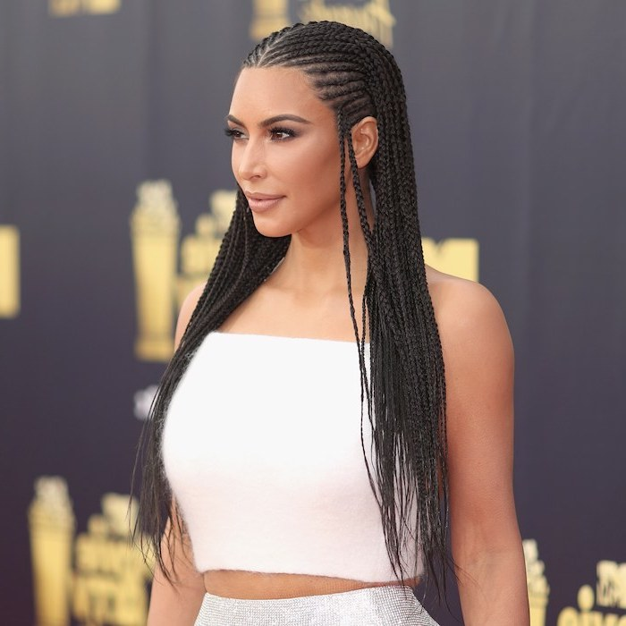 kim kardashian, wearing a white crop top, silver skirt, cornrow braid hairstyles, on black hair